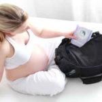 Pregnant and packing bag for hospitalisation